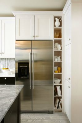 built in fridge with cabinet above and beside