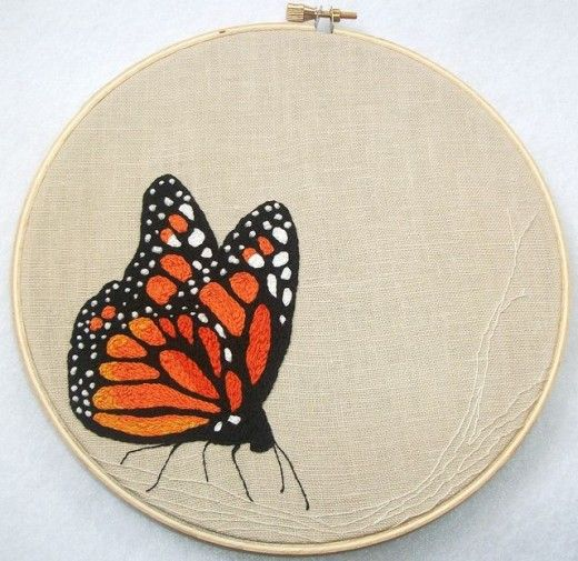 This beautiful butterfly is made up of 'lots of split stitches, some french knots, and a few back stitches' on reclaimed linen.