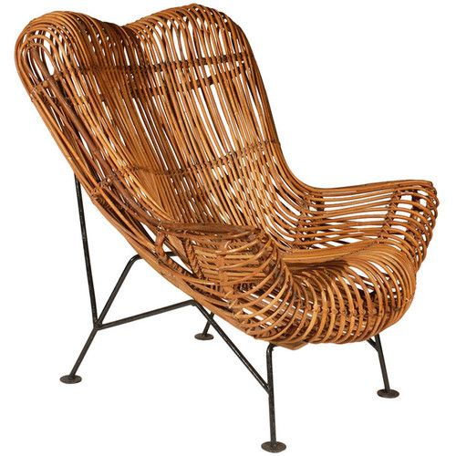 a rattan lounge chair in the style of franco wicker blog pinned