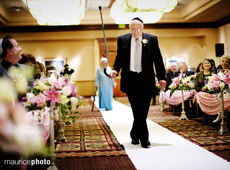 Grandpa twirling his cane as he walks down the aisle at a SeaTac Hilton wedding in #SeattleSouthside. Photo by Maurice Photo