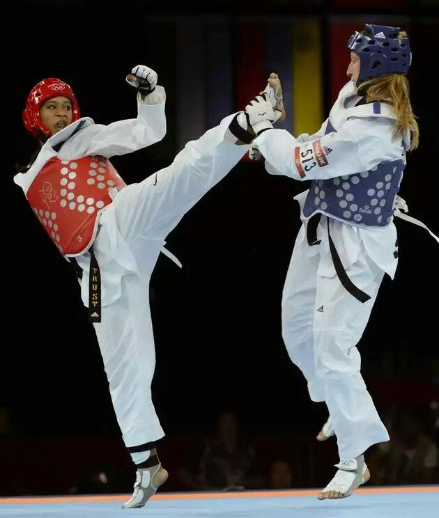 Slovenia's Franka Anic (blue) fights against US athlete Paige Mcpherson (red) during their women's taekwondo bronze medal bout as part of the London 2012 Olympic games, on August 10, 2012.
