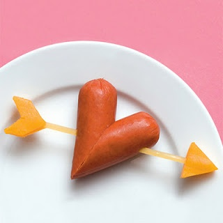 Ingredients hot-dog piece of uncooked linguini cheese Instructions Cut the ends from a hot-dog at a diagonal and place the cut edges together as shown. Spear the heart with a length of uncooked linguini. Add pieces of cheese trimmed to resemble the ends of an arrow.