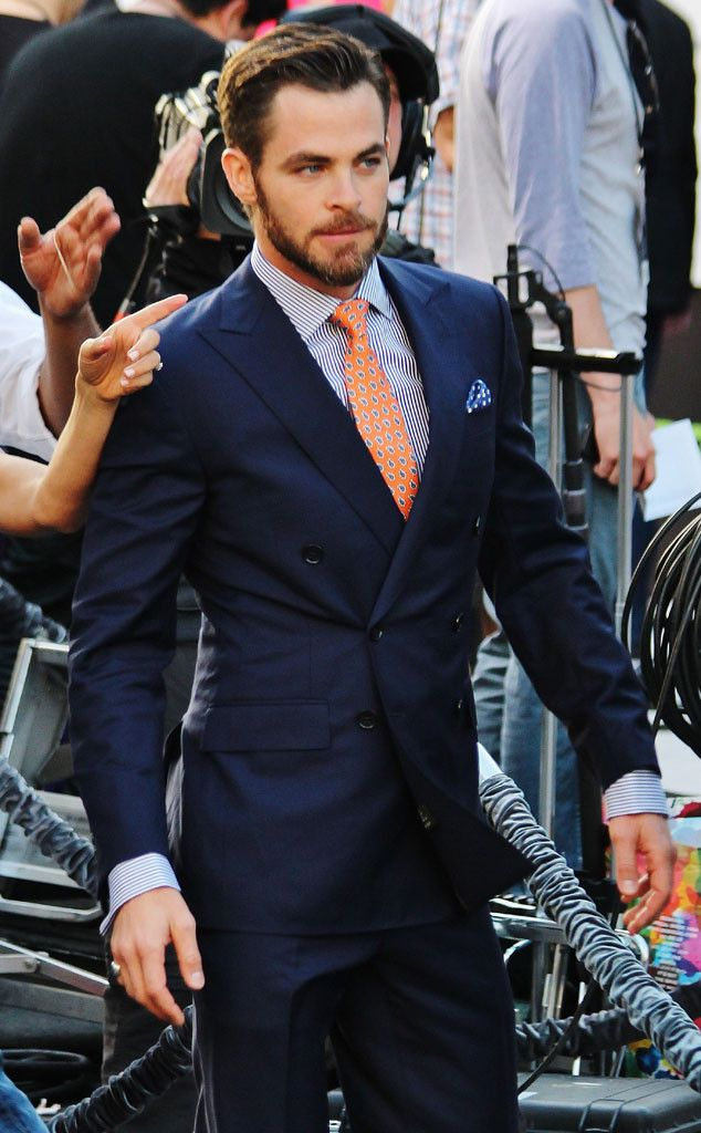 Navy double breasted suit, orange tie. Love the suit colour