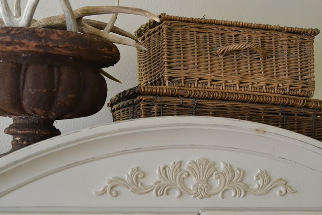 Faded Charm / love the sheds of antlers in the urn next to the baskets