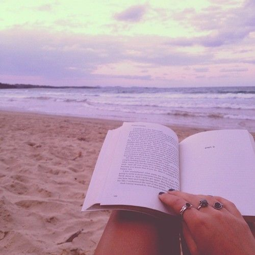 All a girl really needs is a book and the beach...and maybe a cocktail.