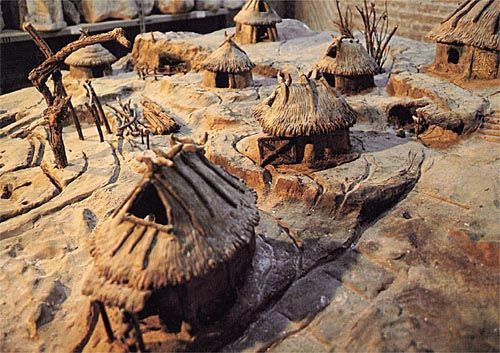 First Roman Huts: symbolic of the huts on the Palatine Hill by Romulus' wall, image of a model.