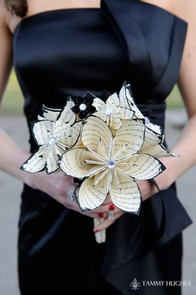 Paper wedding flowers... these would look so awesome on black linens with little red candle holders.
