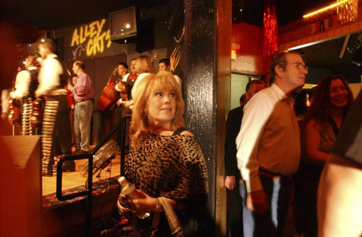 Grammy Award winner Vikki Carr and actor Tommy Lee Jones prepare to go on stage with other entertainers and guests to start a Katrina Relief Concert at Graham Central Station in 2005. Carr sang God Bless America. Photo: Gloria Ferniz /San Antonio Express-News / SAN ANTONIO EXPRESS-NEWS