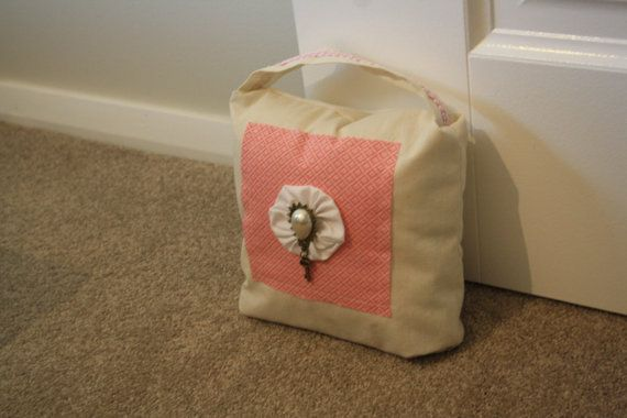 Who cant resist this gorgeous handbag style doorstopper? Completely chic in every way! (notice the vintage embellishment?...yes of course you did)