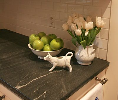 I'm surprisingly loving soapstone more and more. This just might be the perfect thing for my counters.