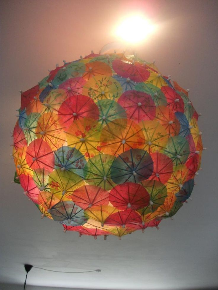 Paper parasol lampshade... it reminds me of that huge piece of artwork with the paper parasols