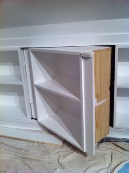 Hide an attic crawlspace with a set of shelves, but leave a secret door for access!