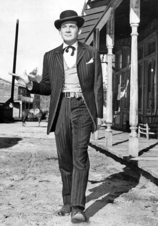 Gene Barry asBat Masterson.....he wore a cane & derby hat...my grandpa had a 'Bat Masterson' cane which was headed in pure silver....I used to rest my lips on it because the strong metallic taste was so interesting.