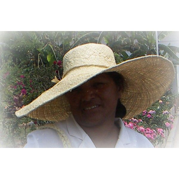 A great Fair Trade hat on its designer and craftswoman in rural Africa; Mme Raton. Click to learn more about her - and find the hat in La Maison Afrique FAIR TRADE assortment.