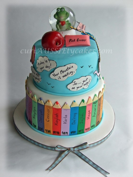 """Made for my sons teacher who was leaving. Top tier was her favorite book """"see how far you'll go"""" and bottom tier were cryaons with all her students names on them. Things on top were her fav animal , and teacher related items, all edible except snow globe as we wanted her to have something to remember."""