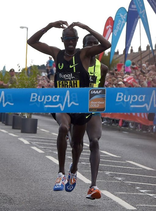 Mo Farah of Great Britain celebrates winning the 33rd Great North Run on Sunday 7th September 2014.