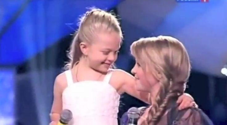 "9 yr. old Anastasia and big sister, Viktoria sing the sweetest, most heavenly version of ""When You Believe"".  Not only did God bless these sisters with voices of angels, he gave them the bond of friendship."