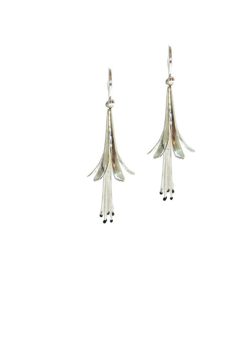 These sterling silver earrings boast curling petals that reveal black enamel encrusted stigmas. #silver #contemporary #unique #London  #designer #jewellery  #NudeJewellery