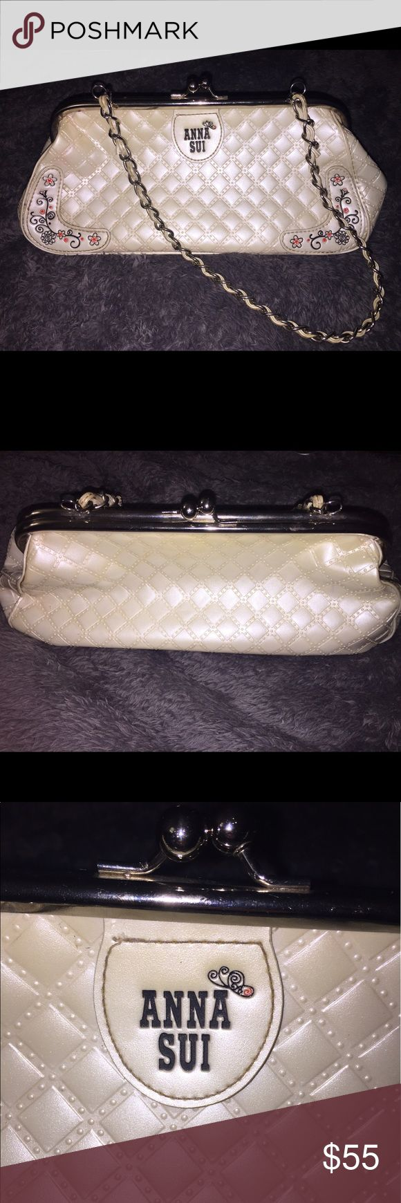 Purse White patent leather Anna Sui shoulder bag. Metal and leather chain strap with red lining on inside. Flower detail on front bottom corners. Anna Sui Bags Shoulder Bags