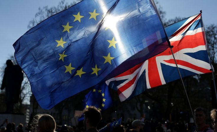 Demonstrators fly an E.U. and a Union flag during a rally following an anti-Brexit, pro-European Union march in London on March 25, 2017. (AFP PHOTO / Daniel LEAL-OLIVAS)  Wednesday was a heady day for the supporters of Brexit, as my Post colleagues Griff Witte and Michael Birnbaum... http://usa.swengen.com/great-britain-will-exit-the-e-u-not-with-a-bang-but-with-a-blinkered-negotiating-strategy/