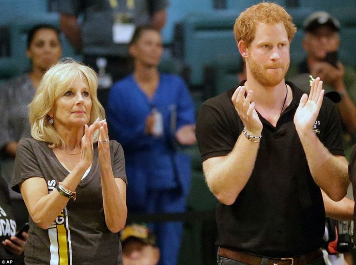 Jill Biden and Prince Harry watch their teams as they compete in the clash on the wheelchair basketball court