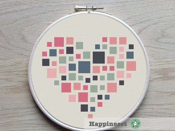 A geometric heart pattern designed to fit a 7 inch embroidery hoop (stitched on 14 count aida)  Try different color combinations and fabrics to create