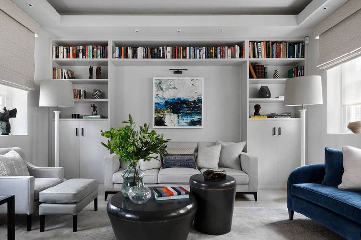 Colorful books in a neutral colored living room.