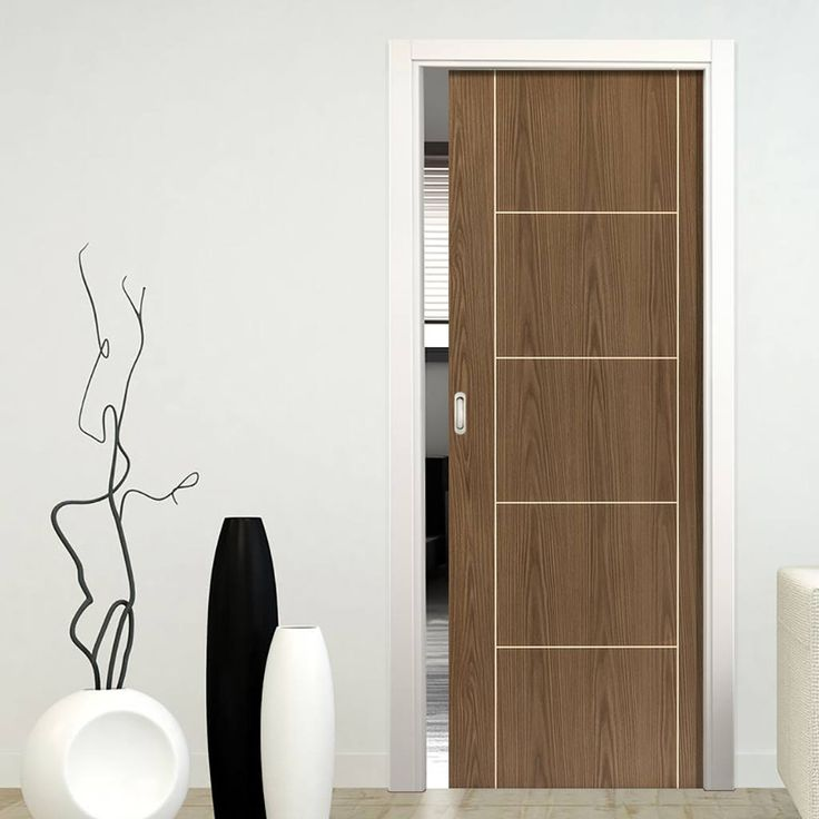 Single Pocket Eco Mocha Walnut sliding door system in three sizes.  #pocketdoor #walnutpocketdoor #slidingdoor