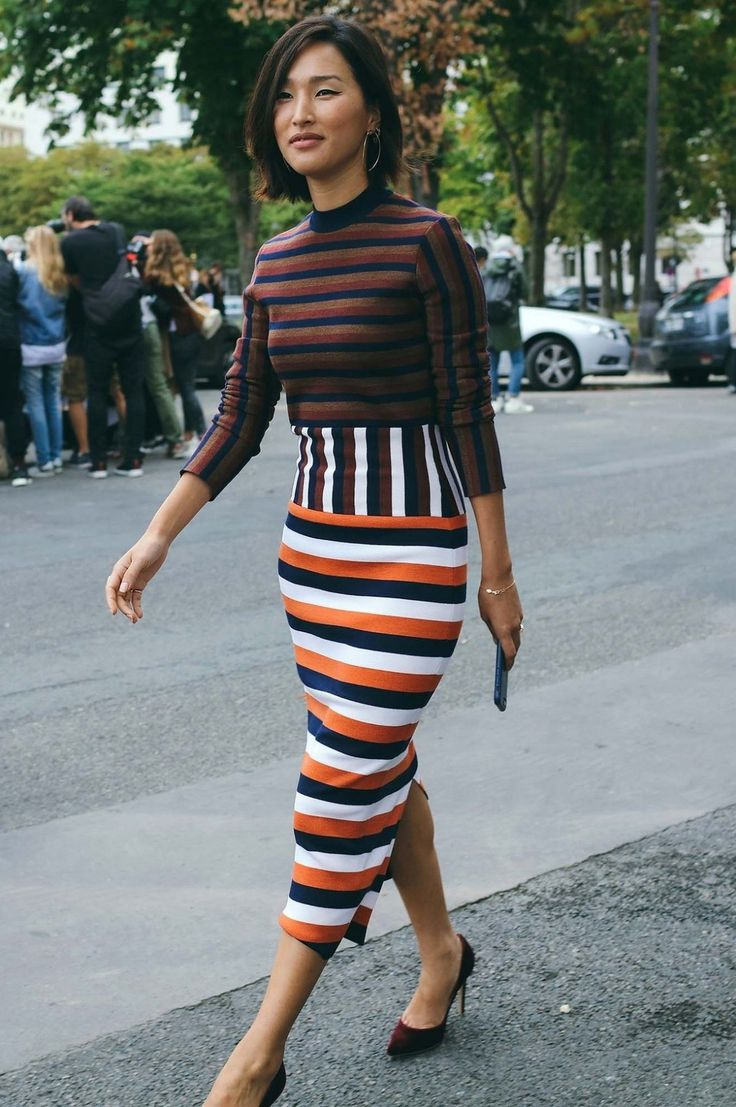 Nicole Warne spotted on the street at Paris Fashion Week. Photographed by Phil Oh.