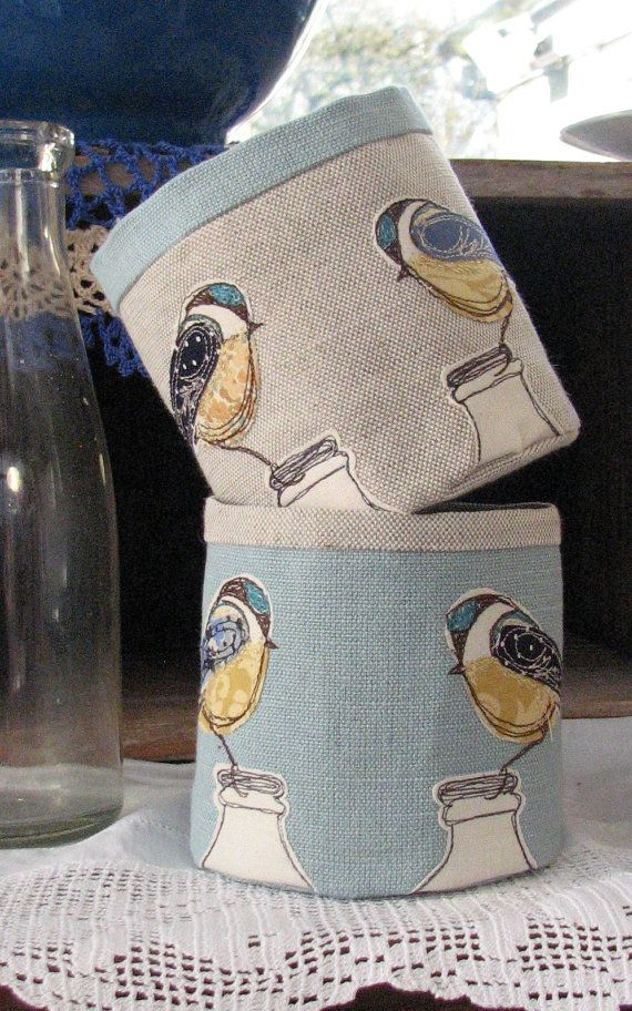 Little fabric pot with two scruffy little blue tits perched on milk bottles. on Etsy, £24.66