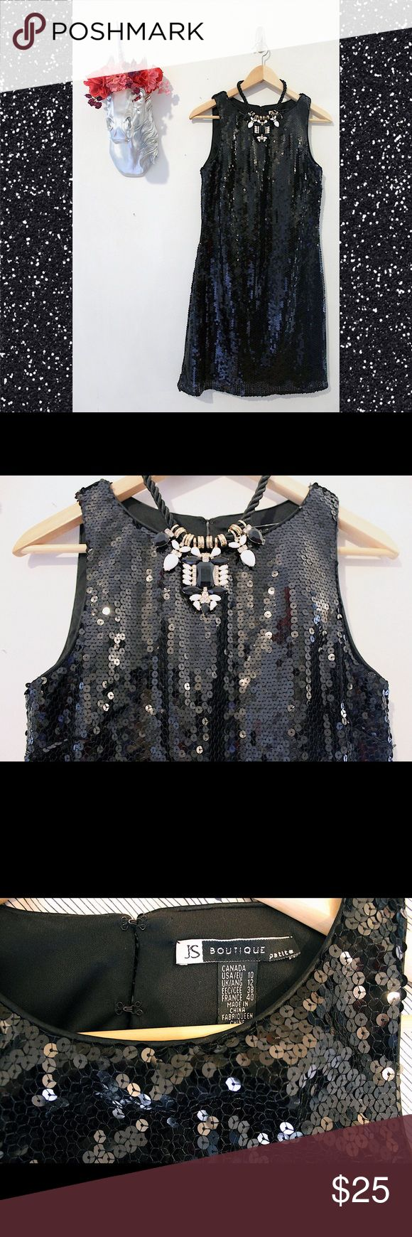 JS Boutique Petite Sequin Dress ✨👯✨ This black sleeveless sequin dress is perfect for any formal occasion! Covered in sequins with a black lining underneath and four small hook fasteners, starting at the top of the neckline, for a secure closure. This has been sitting in storage so there are a few loose strings but never worn and in like new condition. Please note this is petite sizing. 100% polyester. JS Boutique Dresses Midi