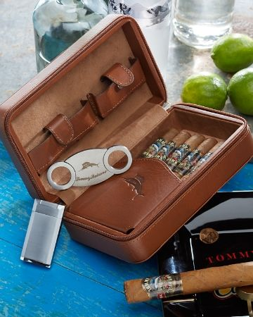 On weekends away or overnights to the coast, this leather travel case has everything you need to transport your cigars in safety and style. An interior leather sleeve, debossed with our contrast sailfish, secures up to five cigars with ease. Also included is a single jet flame lighter with a built-in punch and a stainless-steel cutter. A zipper closure keeps everything secure. Our Tommy Bahama® logo is debossed on the outside. Imported. TH33486.