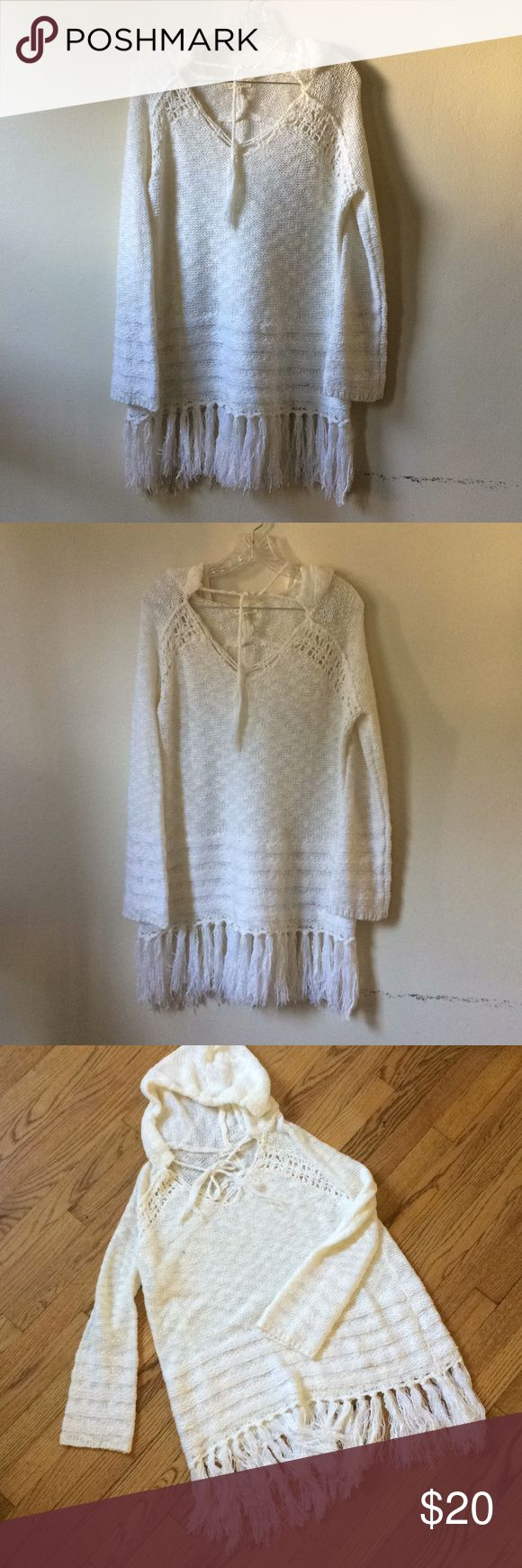 Phanuel ivory hooded knit fringed sweater This sweater was originally bought at Angl. It's in perfect condition, only worn once! No spots, stains, or holes! It's a little longer, hits at the thighs. This sweater is timeless, and is perfect for cozying up next to a beach fire on a summer night or throwing over some skinnies or leggings in the fall and winter months! Dress it up with some camel leather boots or down with your favorite Uggs. ANGL Sweaters V-Necks