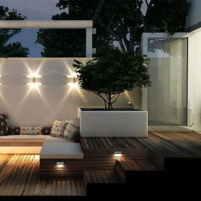 Wood decking , white rendered walls and raised contemporary planter - fabulous garden/patio lighting