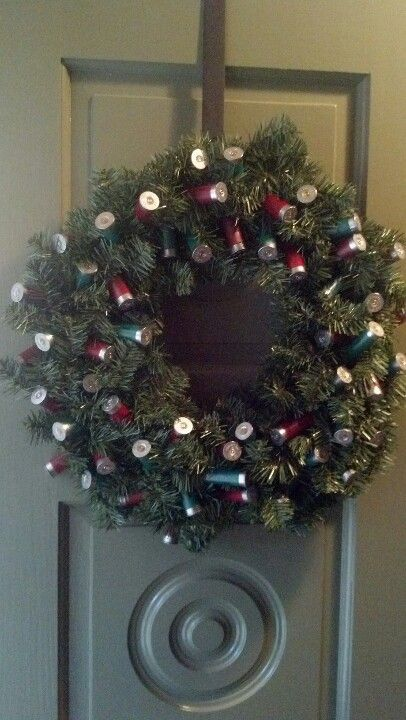 Shot gun shell wreath :-) I used a small drill bit through the ends then wired it to the wreath.