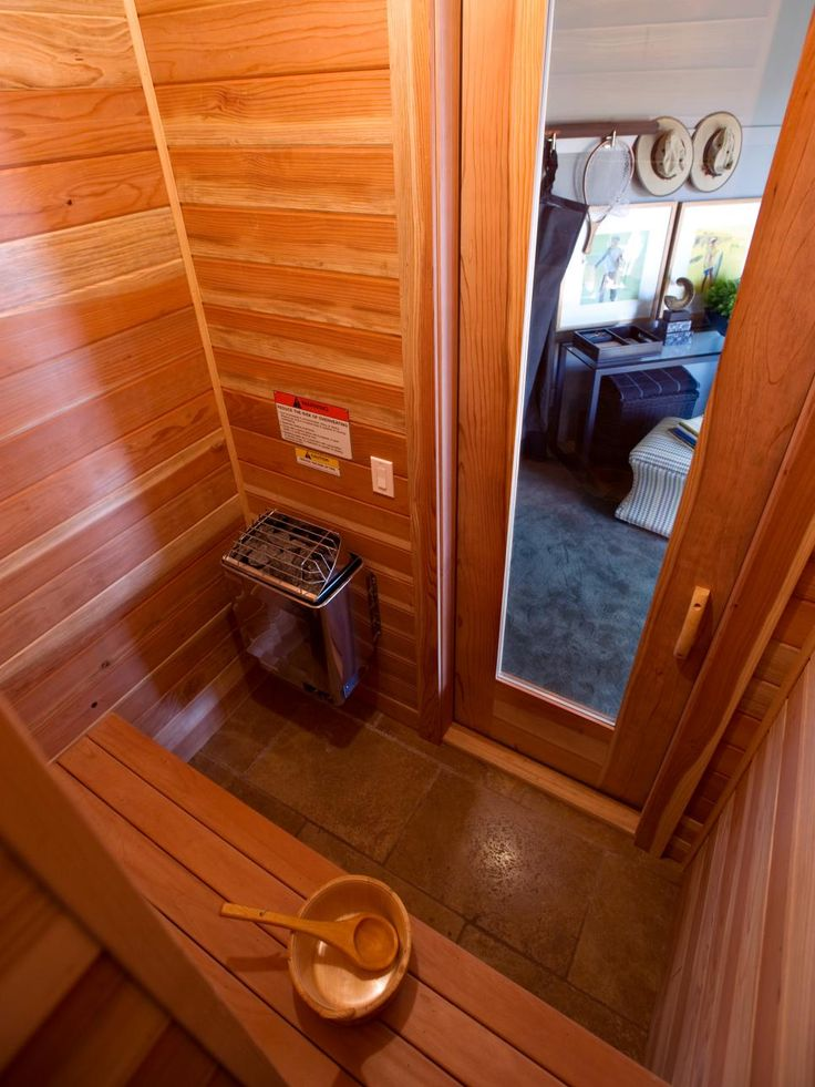 The compact 3-by-5-foot space is clad, walls to ceiling, in tongue-and-grove air-cured red cedar boards. A travertine-tile floor complements the wood interior.