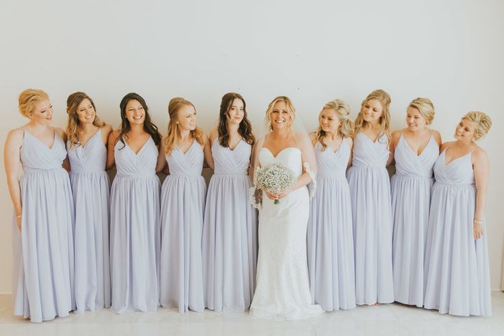 Bride with bridesmaids in beautiful long, pale lilac bridesmaid dresses #weddingattire