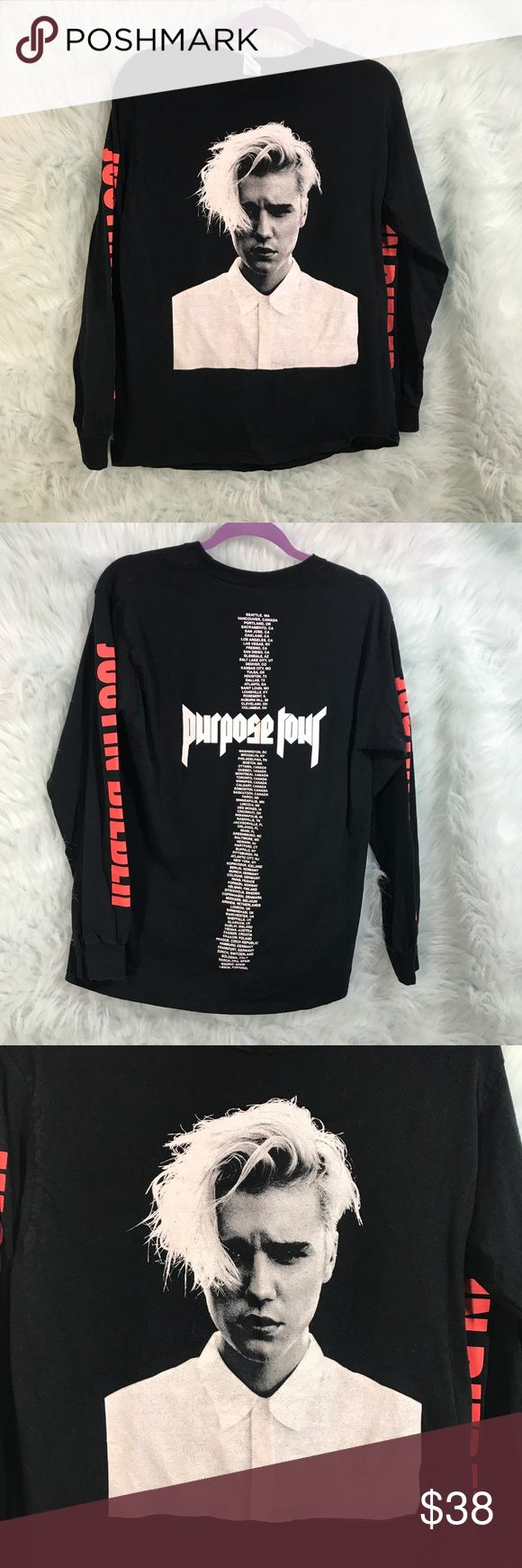 Justin Bieber Purpose Tour Long Sleeve Black Tee * Justin Bieber Purpose World Tour Long Sleeve Black T-Shirt w/ World Tour Dates Listed on Back * Size Medium * Made of 100% cotton.  * Pre-owned, but in excellent used condition. No holes, stains or pilling.  * Measurements: Underarm to underarm is 19 inches. Length is 27 inches. Justin Bieber Tops Tees - Long Sleeve