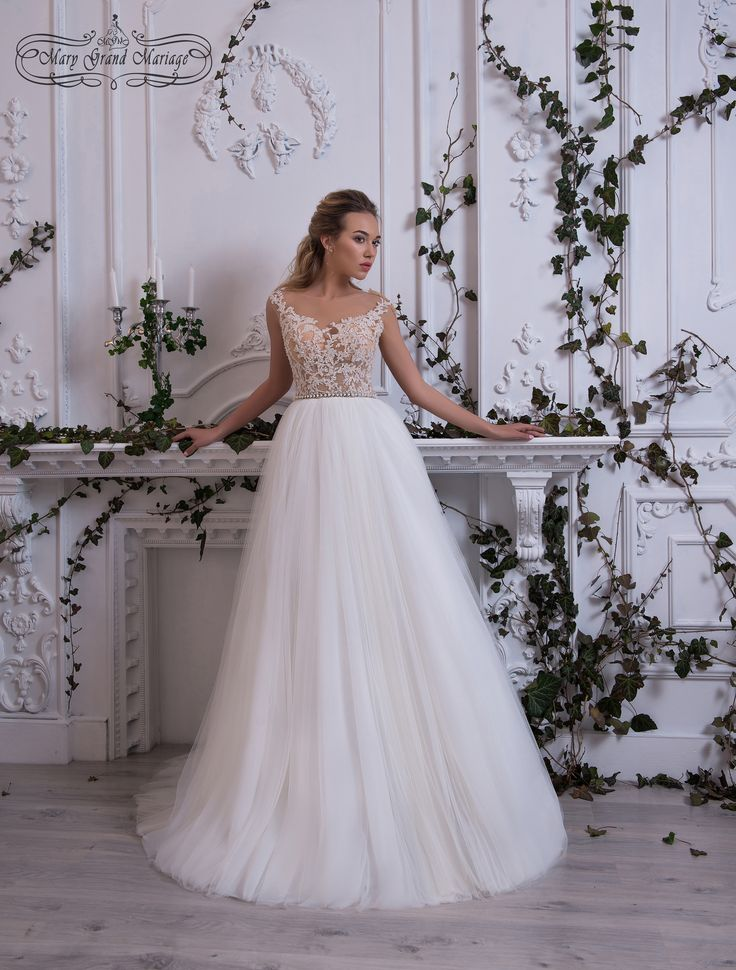Tiara An exquisite #dress with a limpid bodice and a naked back covered with gentle #nude. The skirt is made of flowing layers of #fatin. And only the painting on the back gives this dress some kind of a #mystery.   Свадебные платья новая коллекция 2018 Черновцы Украина #платья #свадьба #одежда #weddingdress