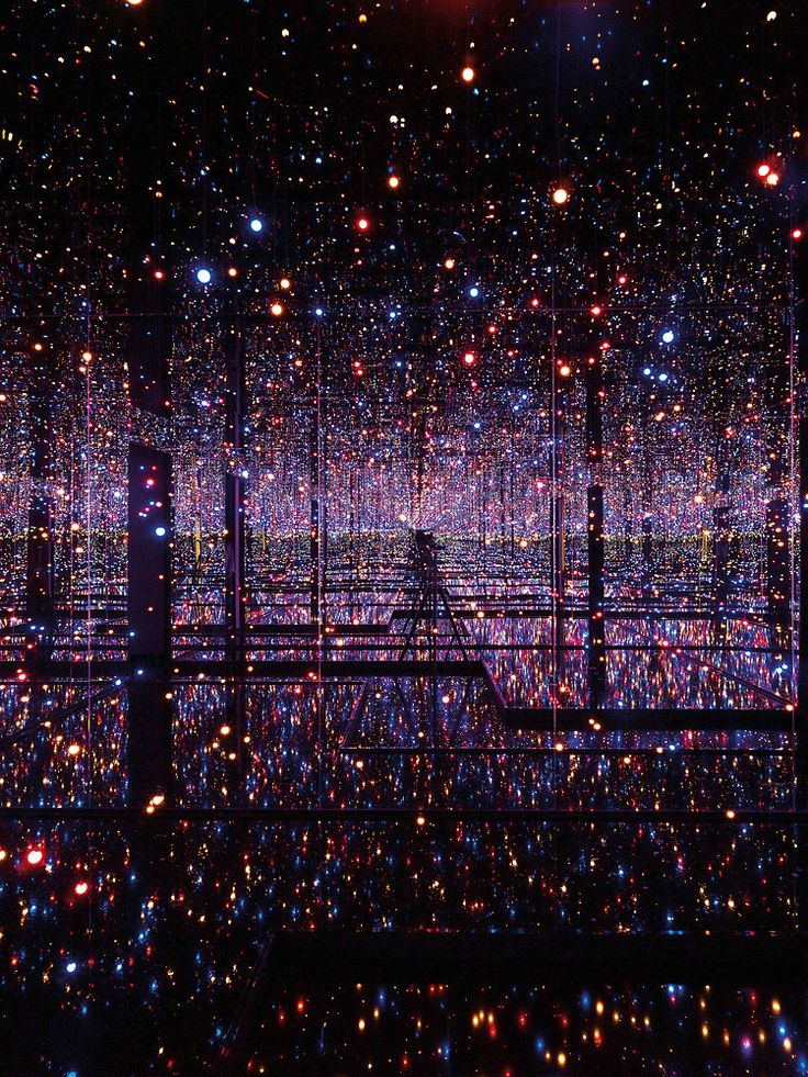 Infinity Room by Yayoi Kusama.     Kusama uses hundreds of LEDs to create what looks like an endless evening of multi-chromatic fireflies, or a galaxy full of Christmas lights, or a blizzard of glowing snow over a city of skyscrapers. As simple as the effect may be—just mirrors and lights—the photos alone are a hypnotic, ephemeral tease of infinity.