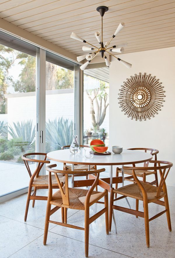 Mid century dining room in palm springs classic architecture terrazzo floors sputnik style light wishbone chairs