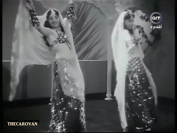 Egyptian bellydancer sisters Lys and Lyn Gamal perform in a scene from the 1954 Egyptian movie 'Al Anisa Hanafi' (Miss Hanafi الآنسه حنفى ), In this scene comedian…