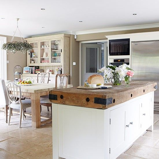 Love everything about this breakfast kitchen; floor, colour scheme, Gustavian style chairs, dresser, adapted butcher's block, funky fridge. Sigh.