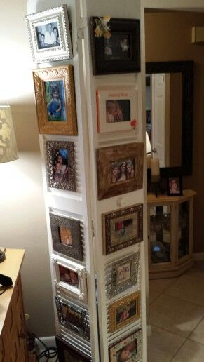 Old bi fold door repurposed into picture holders.