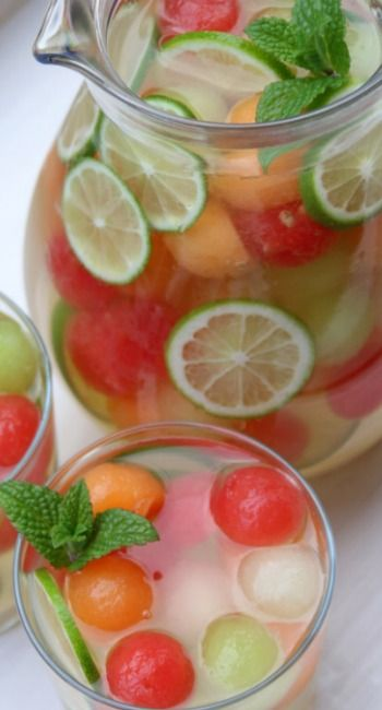 Melon Sangria ~ Refreshing and delicious melon sangria recipe made with a mix of melons, including watermelon, cantaloupe and honeydew melons, moscato wine, honey, lime, grappa (an Italian grape brandy), sparkling water, and mint.