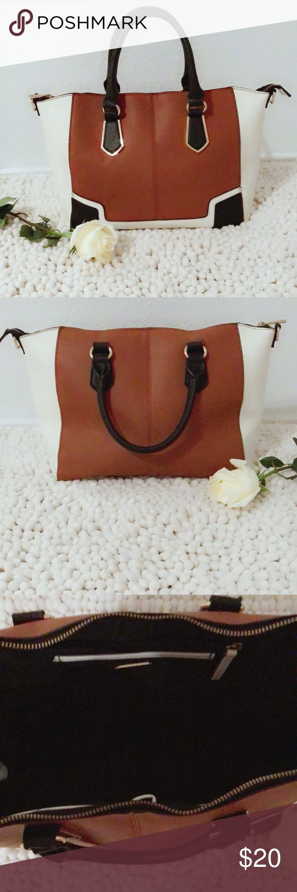 Women's Aldo Tote bag The 'Bremmer' is a satchel by ALDO and it's in the color: white/brown/black preowned- in very good condition Hight length- 10 inches, width 16 inches Free pair of blue earrings with purchase Aldo Bags Totes