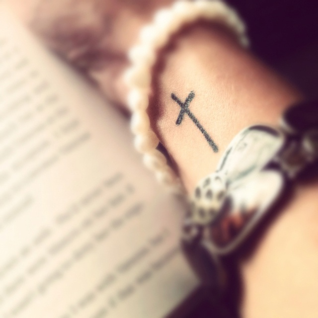 Great cross tattoo ,but maybe  would like it if it were a little off center ?but great size !!!