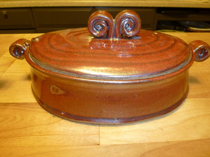 Wheel thrown and altered casserole dish - red ('khaki' glaze)