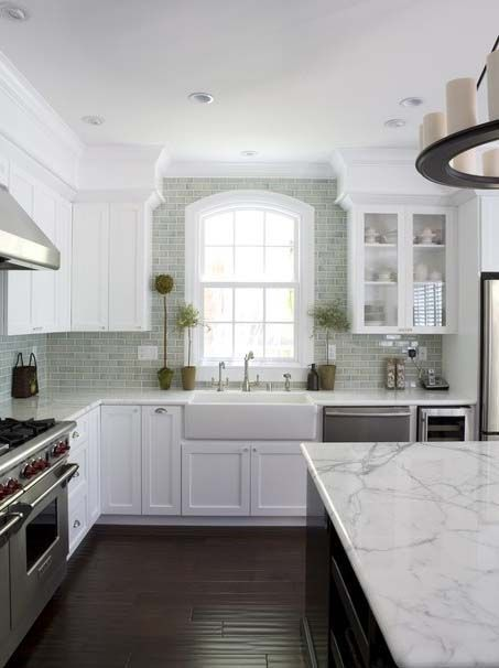 Kitchen Remodeling How to: Love the color contrast of white and dark cabinets, white granite, dark hardwood floor