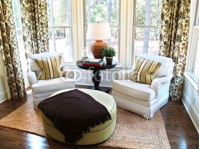 Two comfortable overstuffed chairs in a luxury sunroom by digerati ...